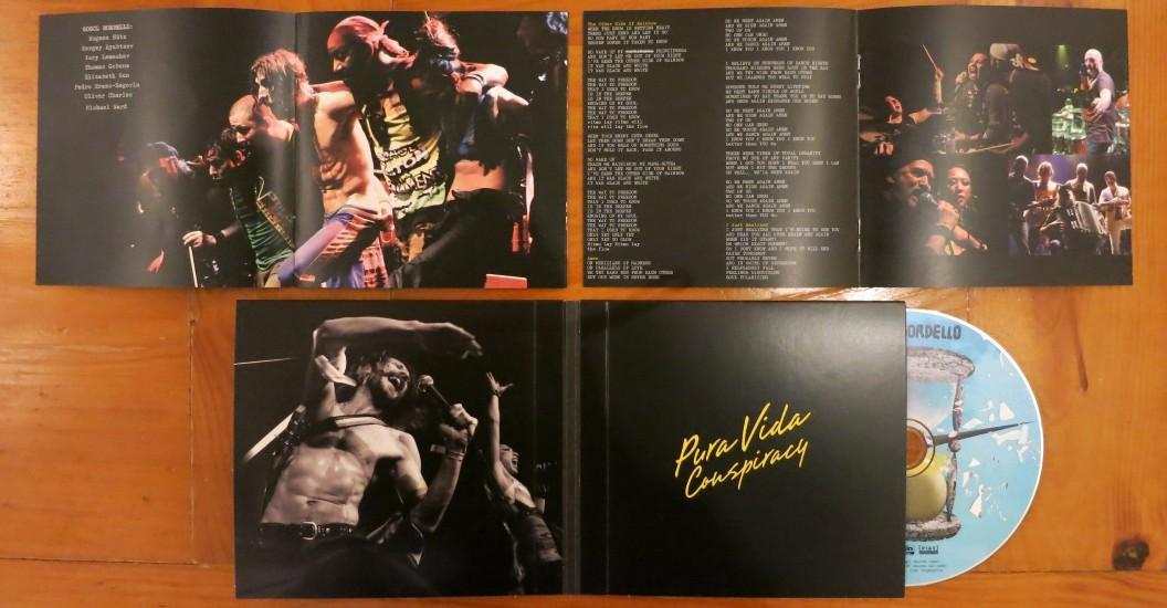 "Gogol Bordello - 'Pura Vida Conspiracy' CD and 12"" album inlay (band line-up; Oliver Charles; Pedro Erazo & Thomas Gobena; Sergey Ryabtsev & Elizabeth Sun; Eugene Hutz & Elizabeth Sun)."
